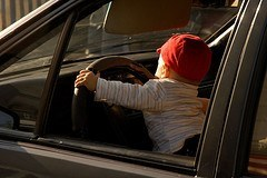 A very young driver.